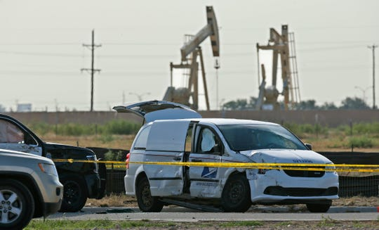 A U.S. Mail vehicle, right, which was involved in Saturday's shooting, is pictured outside the Cinergy entertainment center Sunday, Sept. 1, 2019, in Odessa, Texas.
