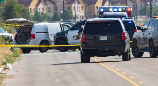 Odessa and Midland police and sheriff's deputies surround a white van in Odessa, Texas, Saturday, Aug. 31, 2019, after reports of gunfire.