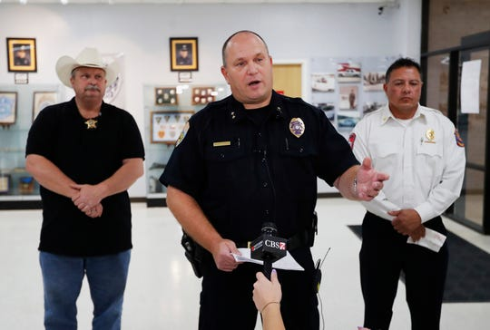 Odessa Police Chief Michael Gerke talks to the media in the Odessa Police Department in Odessa, Texas, Saturday, Aug. 31, 2019, after a man fired at random in the area of Odessa and Midland. Several people were dead after a gunman who hijacked a postal service vehicle in West Texas shot more than 20 people, authorities said Saturday. The gunman was killed and a few law enforcement officers were among the injured.