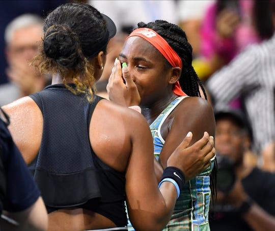 Naomi Osaka comforts Coco Gauff after their third round match.
