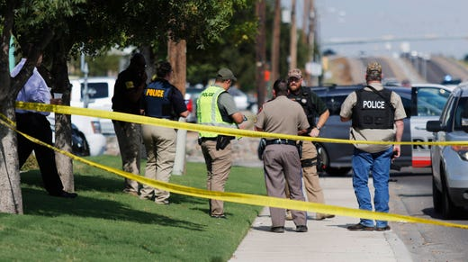 Authorities cordon off a part of the sidewalk in the 5100 block of E. 42nd Street in Odessa, Texas, Saturday, Aug. 31, 2019. Several people were dead after a gunman who hijacked a postal service vehicle in West Texas shot more than 20 people, authorities said Saturday. The gunman was killed and a few law enforcement officers were among the injured.