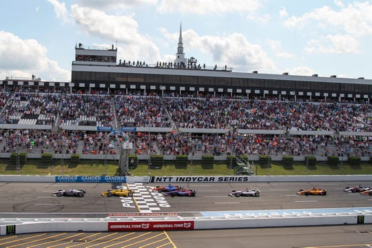 Josef Newgarden (1) leads the field to the green flag to start the 2019 ABC Supply 500 at Pocono Raceway.