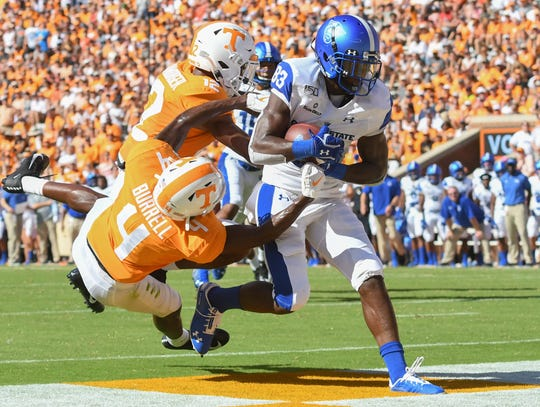 Georgia State receiver Cornelius McCoy (83) hauls in a touchdown catch against Tennessee defenders Warren Burrell (4) and Shawn Shamburger (12).