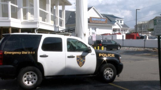 A Sea Bright police vehicle patrols near Donovan's Reef in the town Monday afternoon, September 2, 2019.   A South Plainfield man was charged with leaving a suspicious package with a destructive device was left at the bar Sunday.