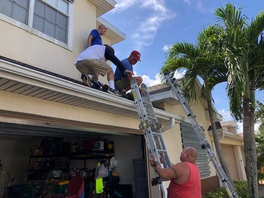 Members of Cross Bridge Church in Rockledge put up hurricane shutters for families -- none of whom attend their church -- in Rockledge and Viera.