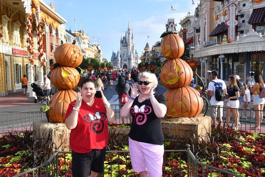 Kari Harris, left, of Vero Beach, got away from pre-Dorian stress by boarding up her house and taking off for Orlando and Walt Disney World. She's pictured with a friend, Rebecca Everett, Monday morning at Magic Kingdom.