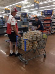 A Walmart associate at the Clearlake Road store assists Red Cross volunteer Terry Kandle of Oregon, who's in Brevard County helping out as Hurricane Dorian approaches. Kandle was picking up $150 worth of breakfast pastries donated by the store to the Walter Butler Community Center shelter.