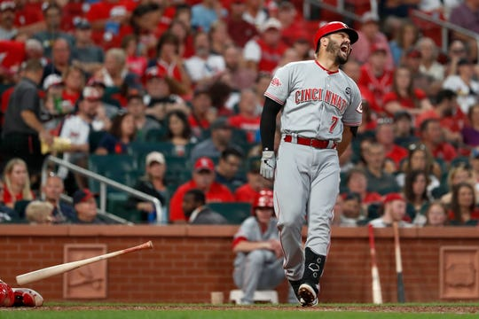 Cincinnati Reds' Eugenio Suarez drops his bat after being hit by a pitch during the fifth inning in the second baseball game of a doubleheader against the St. Louis Cardinals Sunday, Sept. 1, 2019, in St. Louis. Suarez left the game.