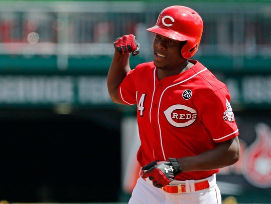 Cincinnati Reds right fielder Aristides Aquino (44) flexes as he rounds the bases on a solo home run in the second inning of the MLB National League game between the Cincinnati Reds and the Philadelphia Phillies at Great American Ball Park in downtown Cincinnati on Monday, Sept. 2, 2019.