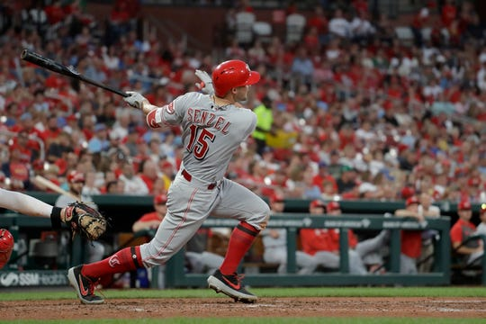 Cincinnati Reds' Nick Senzel watches his solo home run during the fifth inning in the second baseball game of a doubleheader against the St. Louis Cardinals Sunday, Sept. 1, 2019, in St. Louis.