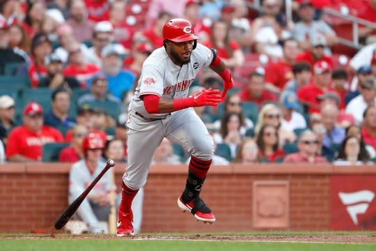 Cincinnati Reds' Phillip Ervin heads to first on an RBI single during the second inning in the second baseball game of a doubleheader against the St. Louis Cardinals Sunday, Sept. 1, 2019, in St. Louis.