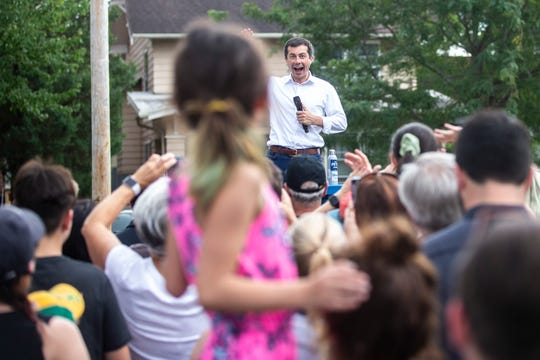 Pete Buttigieg, mayor of South Bend, Indiana, waves to a young supporter during an event after opening a campaign office, Monday, Sept. 2, 2019, at College Green Park in Iowa City, Iowa.