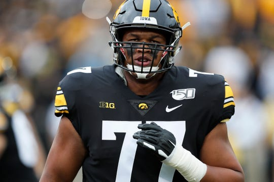 Iowa offensive lineman Alaric Jackson warms up before an NCAA college football game against Miami (Ohio).