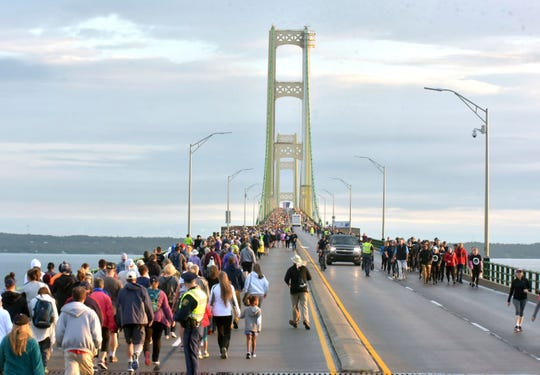 Pedestrians walk the Mackinac Bridge on Monday, Sept. 2, 2019, during the 62nd annual Labor Day Bridge Walk