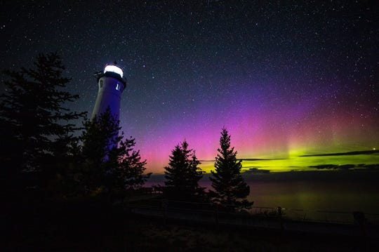 The northern lights viewed from Crisp Point Lighthouse in Newberry on Saturday, Aug. 31, 2019.