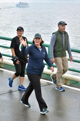 Michigan Governor Grethen Whitmer, center, walks on the Mackinac Bridge on Monday, Sept. 2, 2019, during the 62nd annual Labor Day Bridge Walk. For the second year, the bridge was shut down from 6:30 am until noon for security purposes, allowing walkers to turn around at the center span or walk the entire bridge both ways. (AP Photo/John L. Russell)