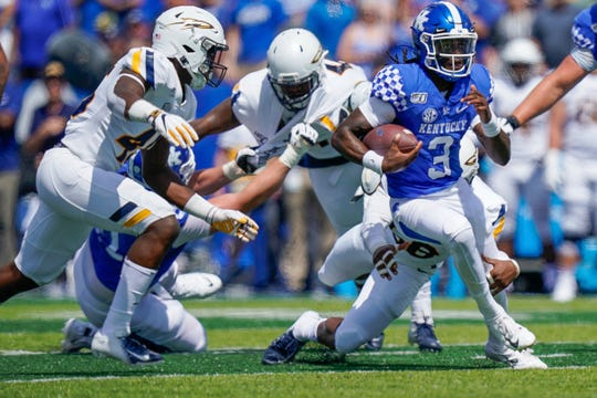Kentucky quarterback Terry Wilson picks up yards against Toledo.