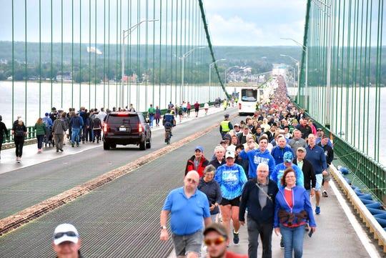 Pedestrians walk the Mackinac Bridge on Monday, Sept. 2, 2019, during the 62nd annual Labor Day Bridge Walk.