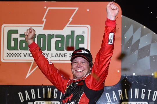 Erik Jones of Byron, Michigan, celebrates his victory after a NASCAR Cup Series auto race on Sunday at Darlington Raceway in Darlington, S.C. Jones held off Joe Gibbs Racing teammate Kyle Busch to win the rain-delayed Southern 500 that ended early Monday morning.