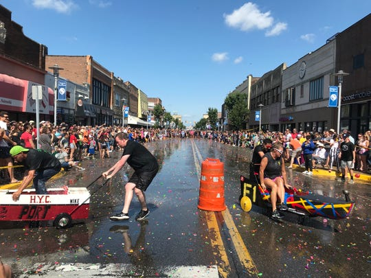 """""""Canoers"""" are deluged with water balloons as they compete in the 2019 Hamtramck Yacht Club Canoe Race."""