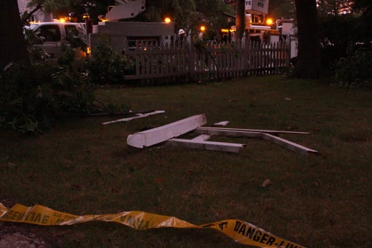 A portion of white picket fence was laying in the front yard of a home on Moross Road in Grosse Pointe Farms after being separated from the rest of the fence when an SUV hit it on Saturday, August 31 around 5:30 p.m.