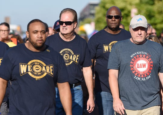 UAW President Gary Jones, second from left, whose home was raided by federal agents Wednesday as part of a corruption probe, walked with UAW members during the  first part of the annual Labor Day parade in downtown Detroit, Sept. 2, 2019.