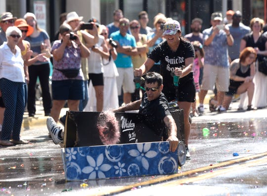 Karl Kaiser and Amy Memminger race down Jos. Campau in this file photo from Sept. 5, 2016.