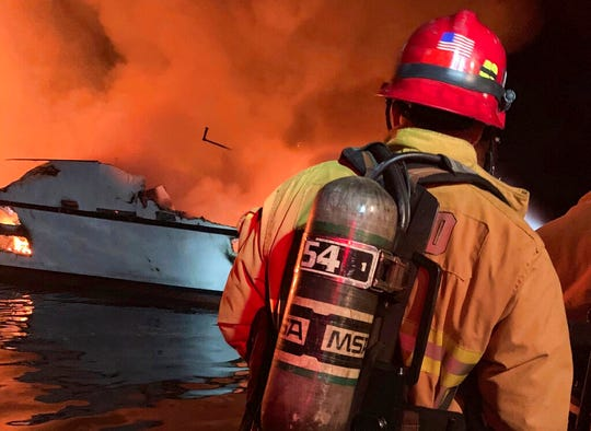 "In this photo provided by the Ventura County Fire Department, VCFD firefighters respond to a boat fire off the coast of southern California, Monday, Sept. 2, 2019. The U.S. Coast Guard said it has launched several boats to help over two dozen people ""in distress"" off the coast of southern California."