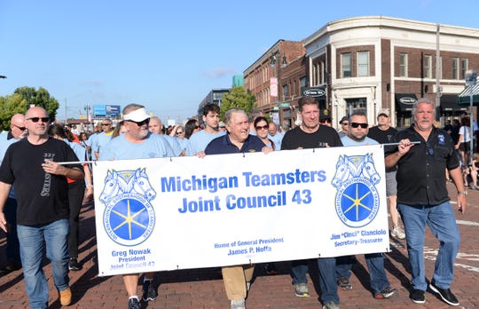 Teamsters President James P. Hoffa, center, marched in Detroit's Labor Day parade.