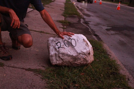 "A white rock with the address ""200"" on it was displaced more than 50 feet after being struck by an SUV on Saturday, August 31"