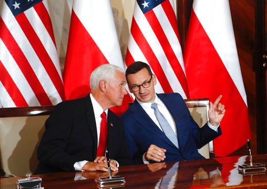 U.S. Vice President Mike Pence and Polish Prime Minister Mateusz Morawiecki, right, speak before signing an agreement in Warsaw, Poland, Monday, Sept. 2, 2019. The U.S. and Poland signed an agreement on Monday to cooperate on new 5G technology amid growing concerns about Chinese telecommunications giant Huawei.