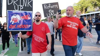 Brian Kelly of UAW Local 1248 and a small group of union members protest corruption at the UAW during the 2019 Labor Day parade in Detroit.