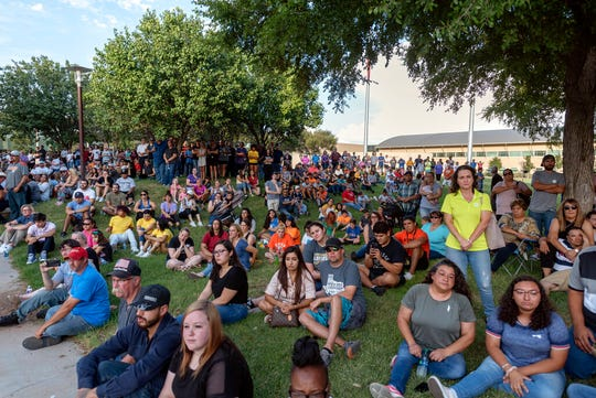 People attend a vigil for victims of a shooting spree the day before, Sunday, Sept. 1, 2019, at the University of Texas of the Permian Basin, in Odessa, Texas.