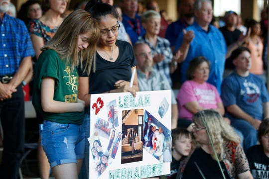 High School students Celeste Lujan, left, and Yasmin Natera, right, mourn their friend, Leila Hernandez, one of the victims of the Saturday shooting in Odessa, at a memorial service Sunday.