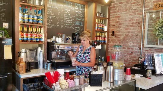 Mary Jo Brugmann creates an Italian soda inside the new Kite and Key Coffee and Tea on Wednesday, Aug. 28, 2019.