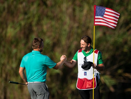 Tom Lewis and his caddie celebrate after his win at the Korn Ferry Tour Championship at Victoria National Golf Club Newburgh, Ind., Monday, Sept. 2, 2019.