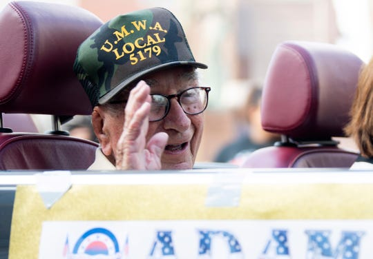 Adam Tooley, 101, of Crestview, Mo., waves to people lining the streets for the annual Labor Day Parade in Princeton, Ind., Monday morning. Tooley is the oldest living member of the United Mine Workers of America Local 5179.