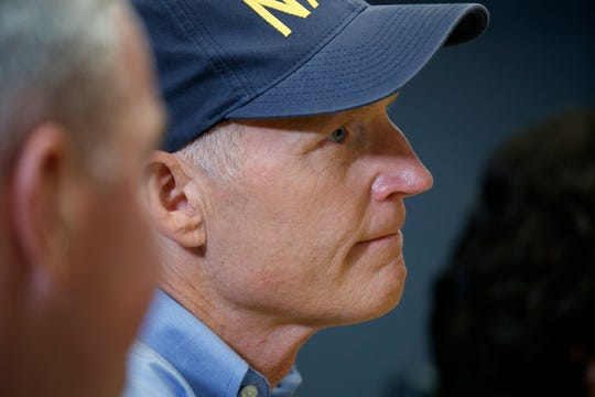 Sen. Rick Scott, R-Fla., listens as President Donald Trump speaks during a briefing about Hurricane Dorian at the Federal Emergency Management Agency (FEMA), Sunday, Sept. 1, 2019, in Washington.