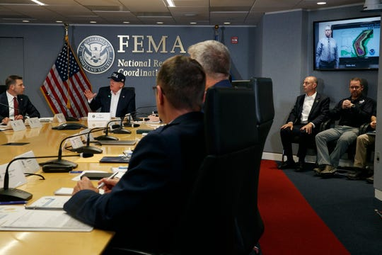 President Donald Trump speaks during a briefing about Hurricane Dorian at the Federal Emergency Management Agency (FEMA), Sunday, Sept. 1, 2019, in Washington, as Acting Homeland Security Secretary Kevin McAleenan, left, looks on.