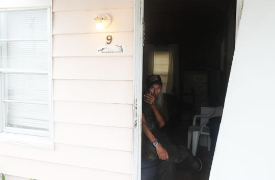 """Bob """"Cowboy"""" Marschat looks out for friends home Monday, September 2,  2019 at Ocean Tide trailer park in Riviera Beach. Marschat says he wasn't leaving no matter what the path of Hurricane Dorian. He lives with a friend, Alfred """"Ace"""" Gritner in a mobile home. Marschat and Gritner live a mandatory evacuation zone but are staying."""