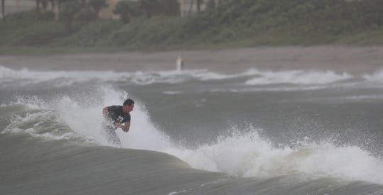Aaron Guest, a resident of Royal Palm Beach surfs at Jupiter Beach Park on Monday, September, 2, 2019. Hurricane Dorian is slowly approaching the east coast of Florida.