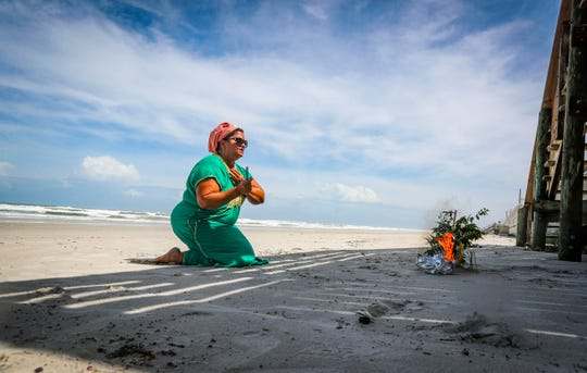 Indira Mary Rambhacus, of Orlando, came to Daytona, Florida, Monday afternoon to pray to Ganesha and ask for protection from Hurricane Dorian. The Daytona Beach area has been put on mandatory evacuation, yet people wanted to see and use the beach one last day.