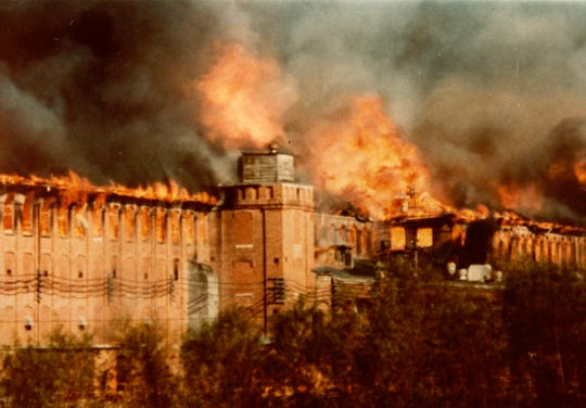 The 1983 fire that destroyed the National Historic Landmark Piedmont Mill left behind a smokestack and piles of rubble.