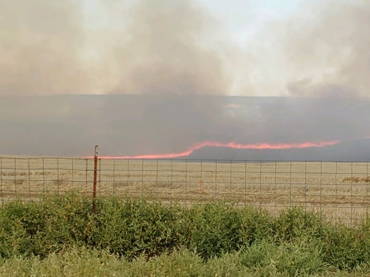 A fire burns in a field north of Great Falls on Monday afternoon.