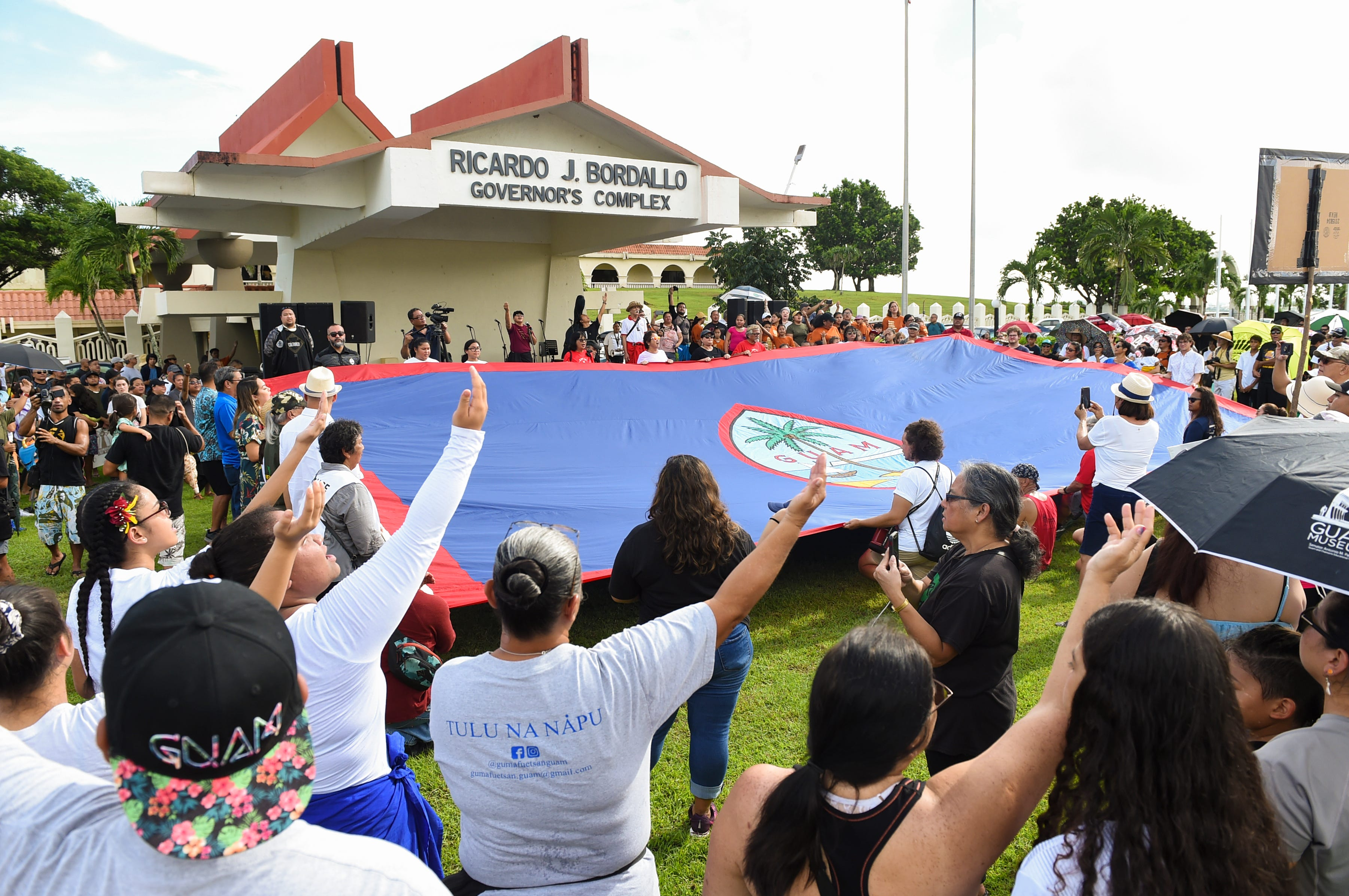Self-determination supporters gather for the Fanohge: CHamoru March for Self-Determination event in Adelup on Sept. 2, 2019.