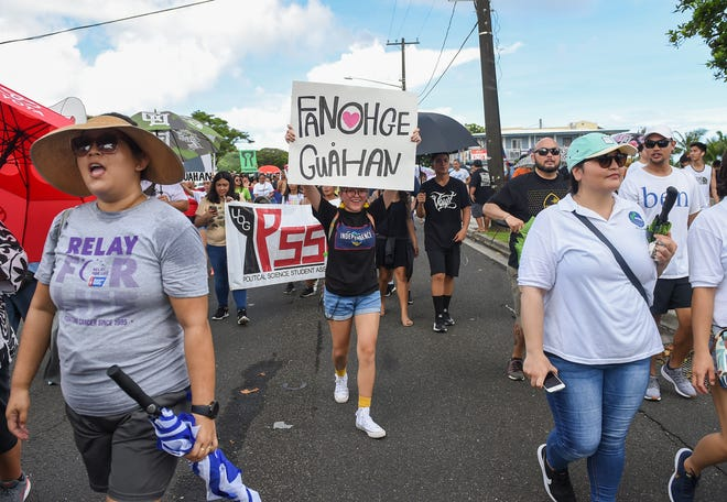 Guam residents in support of self-determination, march toward the Disctrict Court of Guam building on Marine Corps Drive in Hagåtña on Sept. 2, 2019.