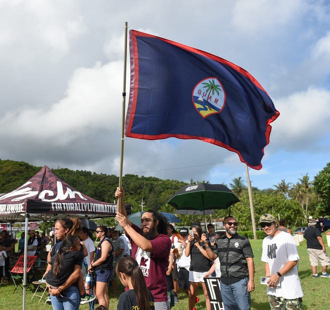 A Guam flag is waved during the Fanohge: CHamoru March for Self-Determination's opening ceremony in Adelup on Sept. 2, 2019.