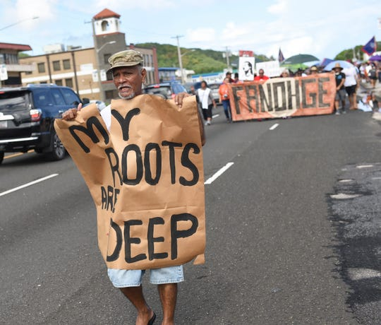 Supporters the Guam's self-determination participate in the Fanohge: CHamoru March for Self-Determination event in Hagåtña are shown in this Sept. 2, 2019, file photo.