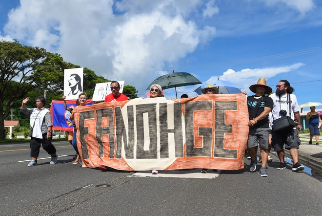 Guam residents in support of self-determination, march toward the Disctrict Court of Guam building on Marine Corps Drive in Hagåtña in this Sept. 2, 2019, file photo.