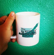 A mug with a logo for The Writers' Rooms, the group organizing the I.O.W.A. festival this year.